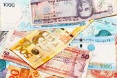 picture of pesos  - A mixed assortment of colorful Filipino Pesos - JPG