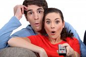 picture of shock awe  - Shocked couple watching television - JPG