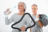 Elderly couple working out together