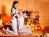 stock photo of thai massage  - Therapist giving Thai stretching massage to woman - JPG