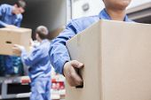 stock photo of movers  - Movers unloading moving van - JPG