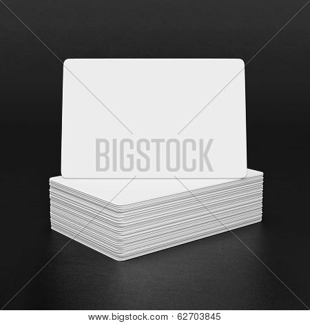 Business cards on a black leather background.