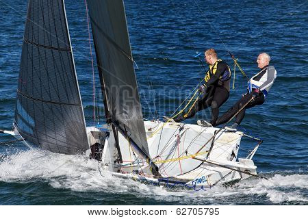 Old and young man yacht racing in Sydney Harbour
