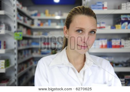 Pharmacist Using Computer And Telephone