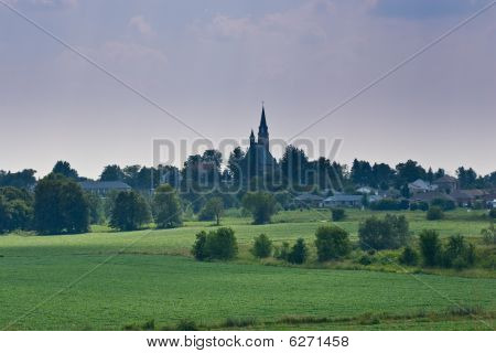 Picturesque Farm Land With Church On The Hill