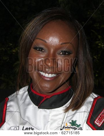 LOS ANGELES - APR 1:  Carmelita Jeter at the Toyota Grand Prix of Long Beach Pro/Celebrity Race Press Day at Long Beach Grand Prix Raceway on April 1, 2014 in Long Beach, CA