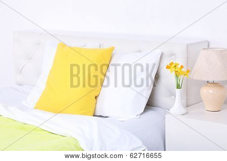 Comfortable soft bed with pillows