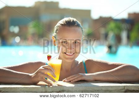 Beautiful young woman drinking a cocktail