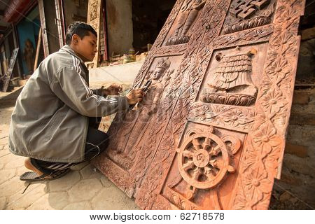BHAKTAPUR, NEPAL - DEC 19, 2013: Unidentified Nepalese man working in the his wood workshop. More 100 cultural groups have created an image Bhaktapur as Capital of Nepal Arts.