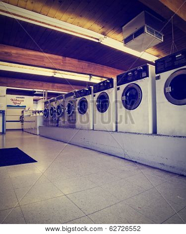 a public coin operated laundry mat done with a retro vintage instagram filter