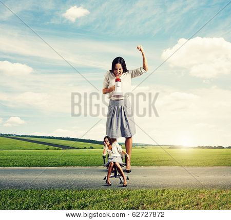 dismal woman and angry screaming woman on the road at outdoor
