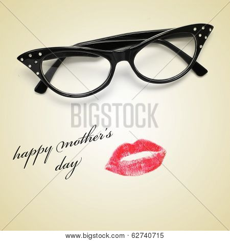 a pair of glasses and a lipstick mark forming a woman face and the sentence happy mothers day
