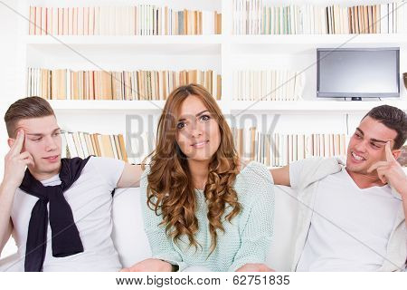 Confused Woman Choosing Between Two Young Men