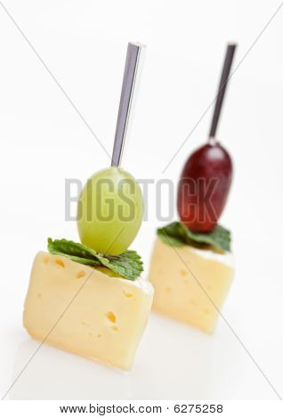 Cheese Canape With Grape And Mint Isolated On White