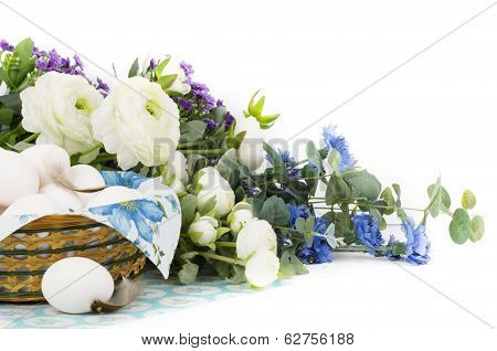 Basket with Easter eggs and spring flowers