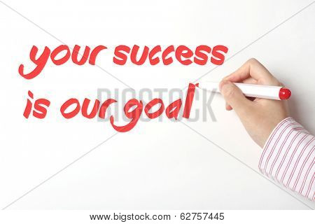 Writing your success is our goal word on whiteboard