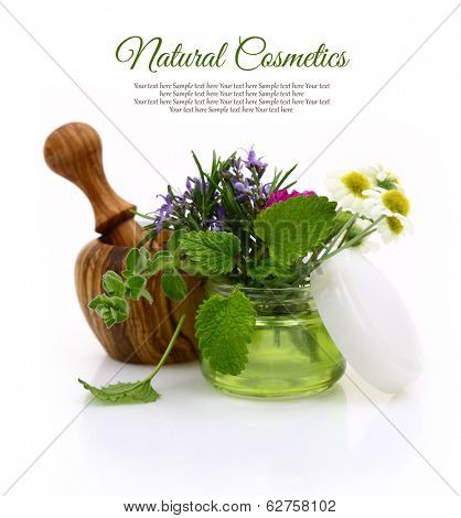 Wooden mortar and cosmetic cream jar with herbs inside
