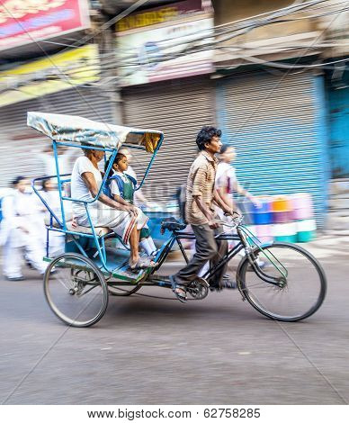 Rickshaw Rider Transports Passenger Early Morning In Delhi