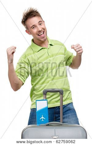 Half-length portrait of man fists gesturing with travel suitcase and ticket, isolated on white