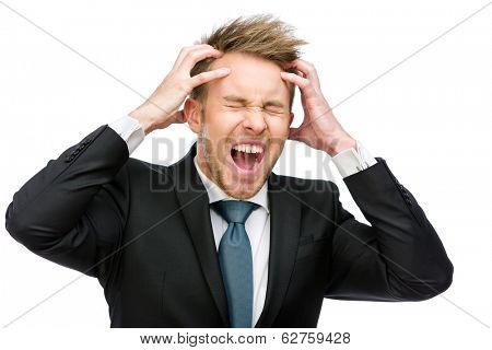 Half-length portrait of businessman with closed eyes putting hands on head and shouting, isolated on white. Concept of headache and high temperature