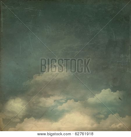 Vintage Background - Grungy textured sky background with fluffy white clouds