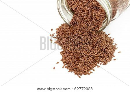 Heap Of Flaxseed In Glass Bottle