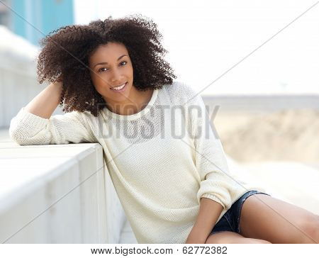 Pretty African Woman Sitting Outdoors