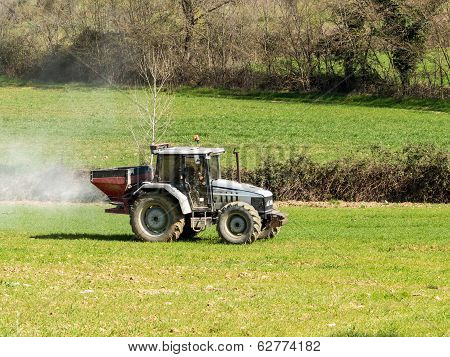 Tractor Working Spreading Fertiliser