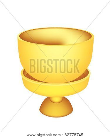 A Golden Bowl With Pedestal On White Background