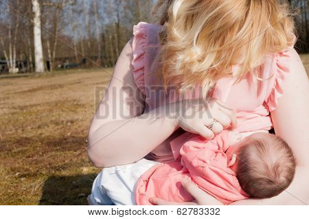 Mother Is Giving Her Baby Breastfeeding