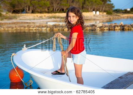 Kid girl pretending to be a sailor in boat bow at Formentera Balearic Islands