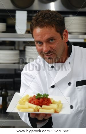 Smiling Chef With Plate Of Pasta