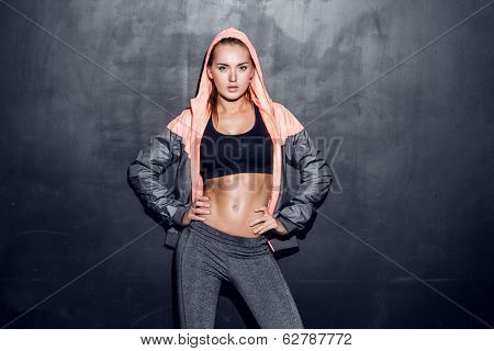 attractive fitness woman listening to music at her smartphone