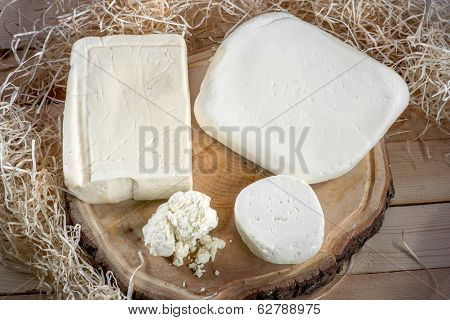Cottage Cheese On Wooden Desk With Hay On Background