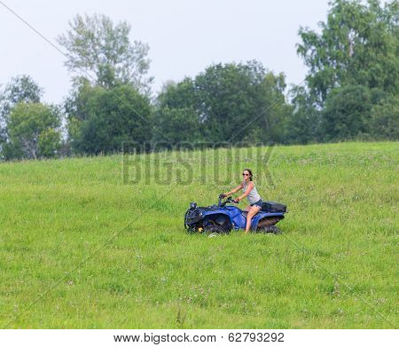 Elegant Woman Riding Extreme Quadrocycle
