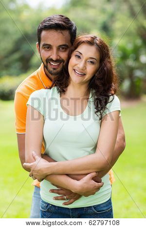 portrait of happy young indian couple enjoying summer day outdoors