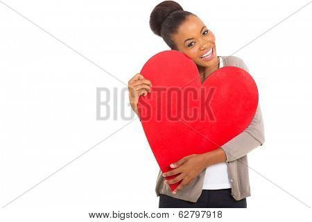 cheerful afro american woman hugging a red heart shape