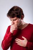 picture of pneumonia  - Ailing young man suffering from pneumonia vertical - JPG