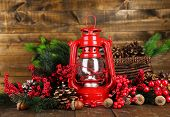 picture of kerosene lamp  - Red kerosene lamp on wooden table on wooden background - JPG