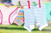 foto of wet pants  - Baby clothes hanging on clothesline - JPG