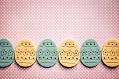 pic of pinky  - Decorated felt easter eggs yellow and blue on a pinky polka dots background - JPG