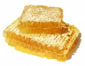 Honeycomb closeup with drops of fresh honey.