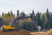 Yellow Excavator At Work