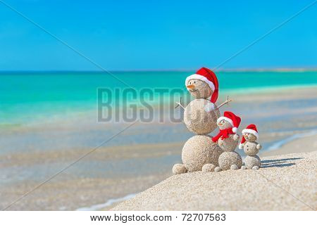 Snowmans Family At Sea Beach In Santa Hat. New Years And Christmas poster