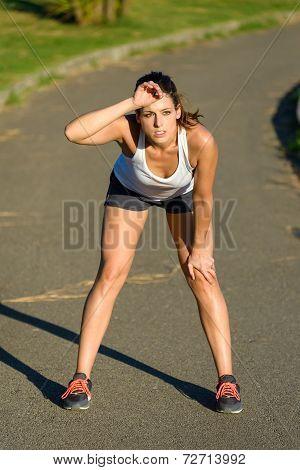 Tired Female Athlete Taking A Running Break