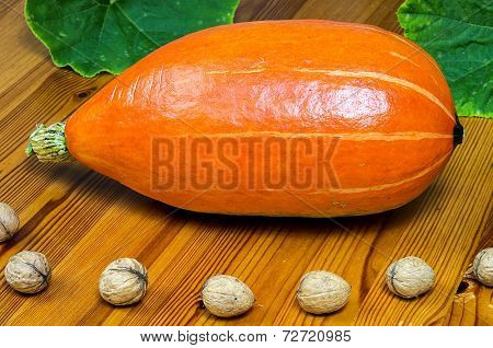 Pumpkins On Wooden Table
