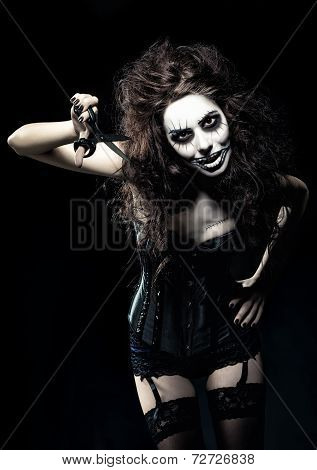 Young Woman In The Image Of Evil Gothic Freak Clown With Scissors