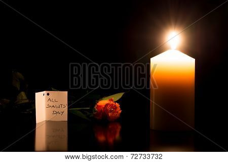 Candle In The Darkness During All Saints Day