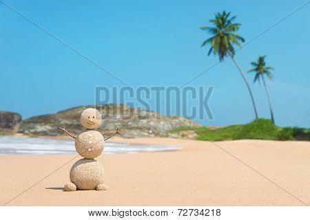 Sandy Man At Ocean Beach Against Blue Sky And Palms - Travel Concept