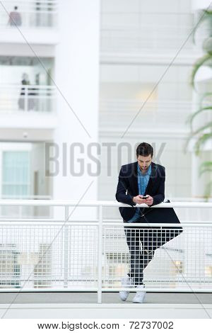 Businessman Standing In Office Building